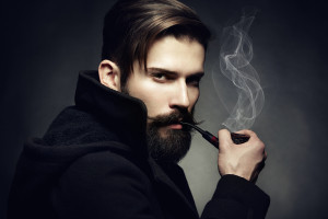 Hipster hairstyle with beard combover